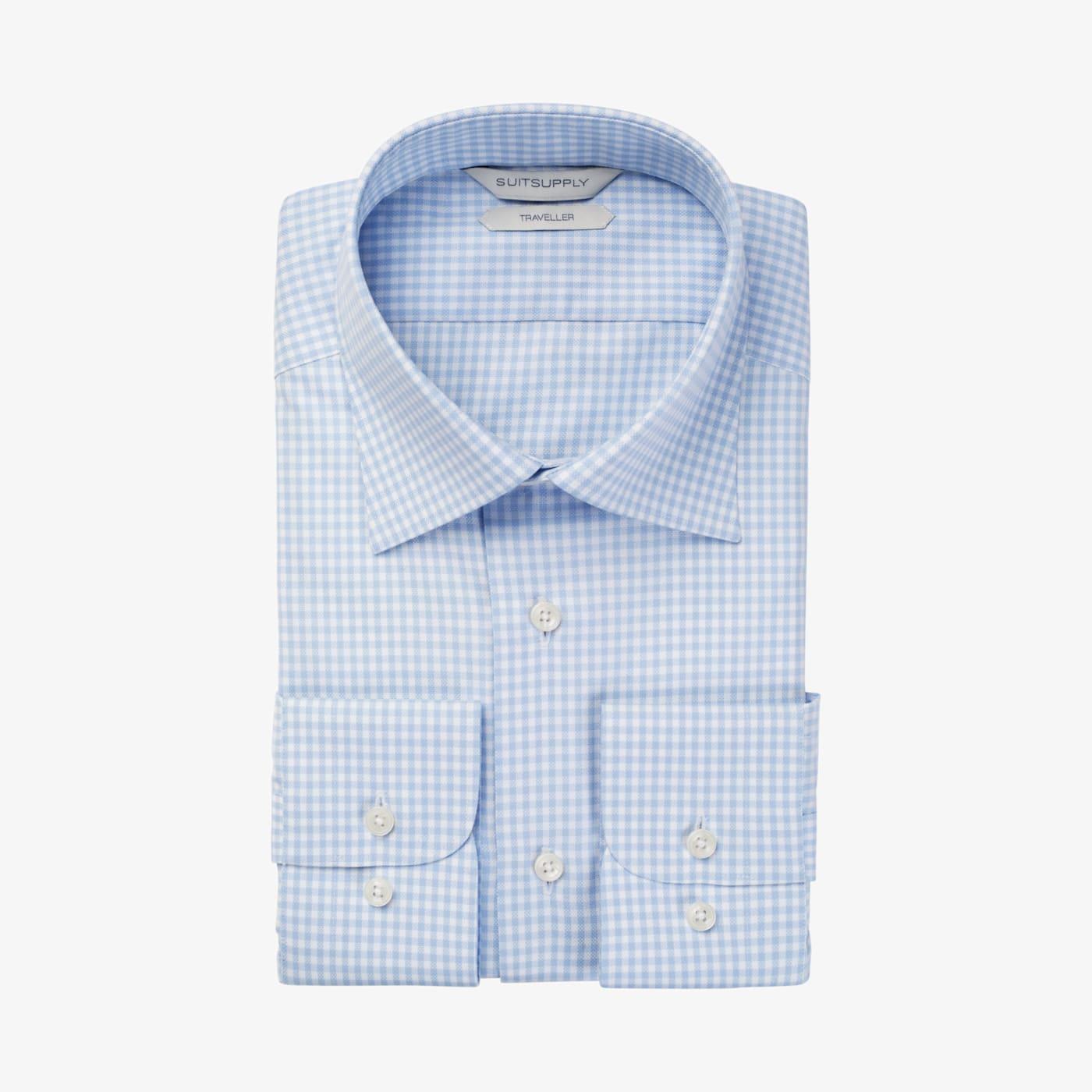 Artikel klicken und genauer betrachten! - Dieses hellblau karierte Hemd besteht aus knitterresistenter Traveller-Vollzwirnbaumwolle. In Slim Fit, mit klassischem Kragen und italienischer Manschette.   im Online Shop kaufen